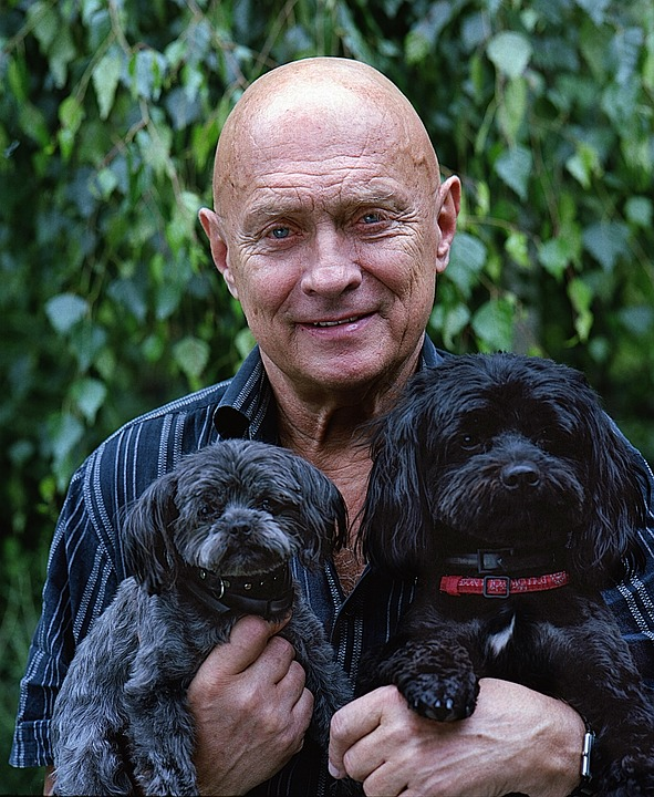 older man with dogs