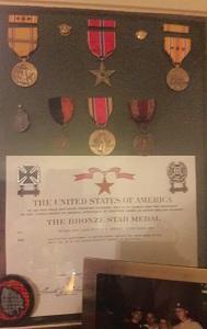 Melville McKenney's display of his Bronze Star Medals and other awards